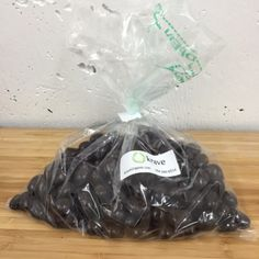 Organic Dark Chocolate Covered Almonds sold by the 100 gram increments:      100 g is approx. 1/4 lb     200 g is approx 1/2 lb     400 g is approx 1 lb