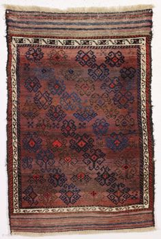 """antique turkish knotted baluch rug in pretty good condition with a wild design and great color. All beautiful natural colors including small bits of fiery red highlights. """"as found"""", with allover good  ..."""