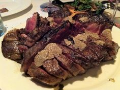 Porterhouse with fresh sliced black truffles | Yelp; Carnevino Restaurant, Palazzo - Did not know how great 90 day aged steak was until going here.