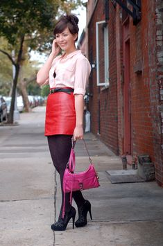 so cute i can't even stand it.  i especially love the red leather skirt and her hair!