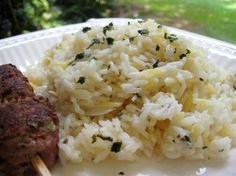 Greek Lemon Pilaf - I added about 4 cloves of minced garlic, throwing it in with the rice, and did without the orzo pasta as I had none.