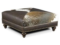 The Juno Cocktail Ottoman is offered in hundreds of leather options and comes standard with Nailhead Trim #54 in a Natural Finish.