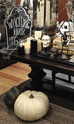 Halloween home decor- great black and white look with skulls, white pumpkins, candles, old books and chalkboard headstones,cob webs too!