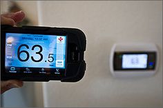 Kevin uses an application on his smart phone to control the thermostat in his townhouse. He has cut his electricity use in half by installing energy-efficient lights, appliances, and meters.