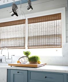 Kitchen sink featuring natural woven tailored shades in for Natural woven flat fold shades