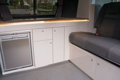 interior in Farrow & Ball 'Pointing' with Walnut worktop – Dubteriors Quality VW Camper Interiors Campervan Interior Volkswagen, Vw T5 Interior, Volkswagen Transporter, Gray Interior, Mercedes Vito Camper, Vw Camper Conversions, Ford Transit Camper, Caravan Makeover, Bespoke Design