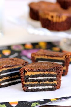 Oreo and Peanut Butter Brownie Cakes    super easy. very rich, couldn't finish an entire one. recipe calls for 1 layer of pb, but will use 1/2 amount for each layers and make 2 layers next time. also, silicone liners, the paper stuck to the brownies a little. will make for picnics and potlucks.