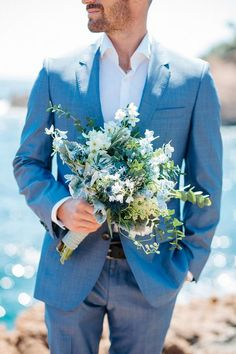 blue wedding theme blue groom suit groom with flower