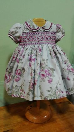 Beautiful smocked child's dress! Love the smocking with that wonderful rose print. That is dark rose thread faggoting work on the collar and cuffs. Really sets the dress off.