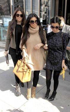 Kim Kardashian wearing Balenciaga Bal 0065s Sunglasses, Christian Louboutin Lipspikes Boots in Leoprad, Hermes 35cm Birkin Bag in Gold, Ralph Lauren Blue Label Cashmere High Neck Poncho in Camel and Rag & Bone Trooper Knit Combo Leggings.