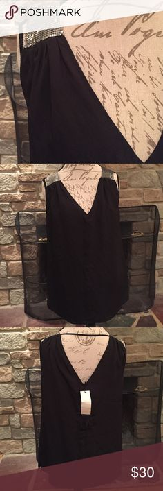 MM Couture by Miss Me top 97%polyester/3%spandex outer shell and lining is 100% polyester. Decorated with studded mesh. 21 inches armpit to armpit. 28 inches from shoulder to bottom. Side slits. MM Couture Tops