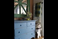 The mirror and dresser get painted to match the bedding.