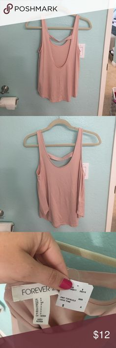 Light pink open back tank top Very cute light pink tank top with open back! Sized as a small but fits more like a medium! Light and flowy! Perfect for summer time! Forever 21 Tops Tank Tops
