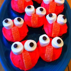 Elmo cupcakes - marshmallows split for eyes, chocolate chips for pupils and orange slices.  Cupcakes and frosting from scratch.  Things Mom does when she can't buy store-bought cakes because little boys have allergies.