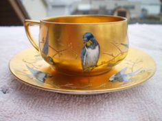 This is a beautiful gold with blue birds dresden cup & saucer. The cup is about 1 in. tall the saucer is 4 across. They both are in excellent shape . Coffee Cup Set, Tea Cup Set, My Cup Of Tea, Tea Cup Saucer, Tea Sets, Teapots And Cups, China Tea Cups, Tea Service, Ceramic Cups