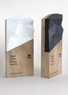 A trophy is an unusual commission for a graphic design studio, but we loved working on this beautiful project for the Logan Urban Design Awards. The shapes in the trophy are derived from the Logan City precinct boundary and were created using a printer… Environmental Graphic Design, Environmental Graphics, Wayfinding Signage, Signage Design, Park Signage, Web Design, Logo Design, Displays, Arts Award