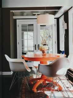 never really liked orange, but painting a table a bright bold color would be fun for an outdoor place
