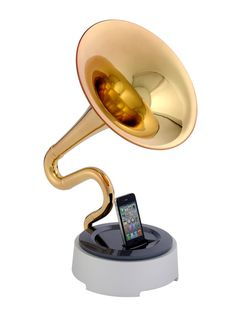 trumstand IPhone Dock from Japan amplifies the sound of your iDevice without electricity. (about $2000/gold & $1800/silver)
