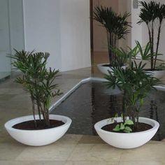 Textured stack displays in an indoor office setting with - Macetas fibra de vidrio ...