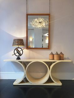 Mirror by Paul T. Frankl / Console by Karl Springer / Lamp by Gilbert Poillerat & André Arbus / Boxes by Claudio Salocchi / Chandelier by Lobmeyr