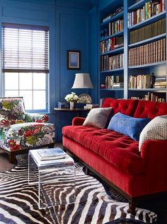 Katie Ridder Inc. pairs our bold #ChiangMai print with dazzling blue walls, red velvet and zebra stripes for a stylish mix. Photo by Eric Piasecki. #Schustagram