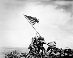 A Pulitzer prize winning photo, this image by Joe Rosenthal shows U.S Marines patriotically raising the flag on top of Mount Suribachi durin...