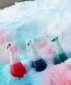 Paint the snow using spray bottles and color. - Cute, but I wonder what it would do to the grass once it melts.