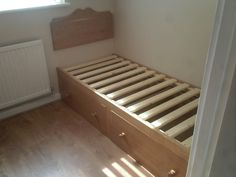 Built in Bed in Cherry opposite a wardrobe( see other picture) in a small bedroom to maximise space.