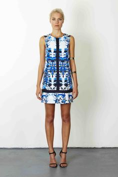 Worship Floral Dress in store and online at www.emclothing.com now!