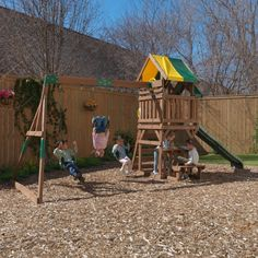A children's wooden outdoor Playset featuring Swings, Slide, Climbing Frame and Chalk Board play area under a canopy. Wall Ladders, Rock Wall, Upper Deck, Outdoor Play, Days Out, Decks, Canopy, Climbing, Backyard