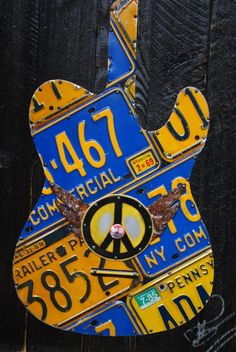 Woodstock 69 license plate guitar from runningonempty, Etsy. License Plate Crafts, License Plate Art, Guitar Art, Cool Guitar, Guitar Songs, Guitar Chords, Luna Guitars, Give Peace A Chance, Joe Cocker