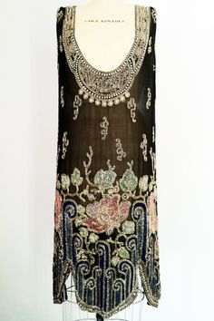 A beaded flapper dress. Sheer black silk features an elaborately art deco beaded neck and hemline. Silk, crystal and glass Front 2 Private Collection 1920 Style, Style Année 20, Flapper Style, 1920s Flapper, Flappers 1920s, Gatsby Style, 20s Fashion, Fashion Moda, Art Deco Fashion