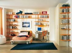 Very airy boy's bedroom with lots of open shelves on all the walls