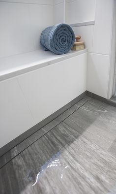 Love the custom built-in bench and niche. The linear, tileable drain is nearly invisible in this barrier free shower.