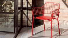 EMU Lyze Seating in a pop of red for the outdoors.