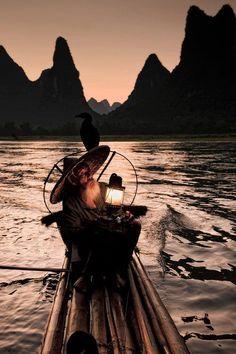 Vietnamese man and his fishing cormorant