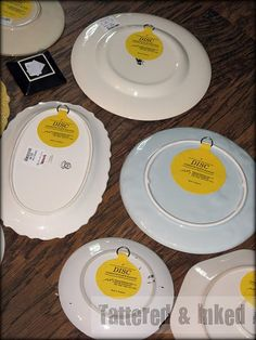 Yellow Disc plate hangers that attach to the back of the plate. Who knew. (Hobby Lobby)
