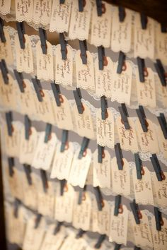 escort cards with clothespins. oh, i like the use of the tags!