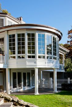 Concord MA sunroom with extensive custom millwork, Marvin windows, copper roof & curved gutter, custom milled v-groove mahogany ceiling.