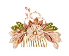 This comb would also be worn by women because the colours used are very pale and feminine. This piece is not very bold due to it's small intricate design and Pastel colours. However it does achieve a very elegant look because of the dainty flower design.