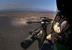 Guns and Military Cpl. Richard Sippl, UH-1Y Venom flight crew chief, fires a 7.62mm GAU-17/A Minigun