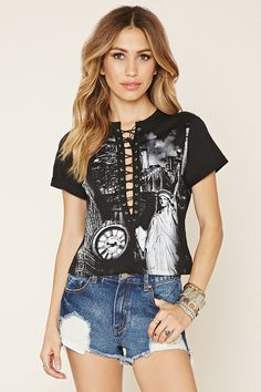 A knit top featuring a plunging lace-up neckline with grommets, cuffed short sleeves, and a front graphic of New York City.