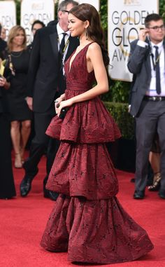 73rd Annual Golden Globe Awards - Singer/actress Zendaya attends the ceremony, she wows in a layered Burgundy layered Marchesa gown.