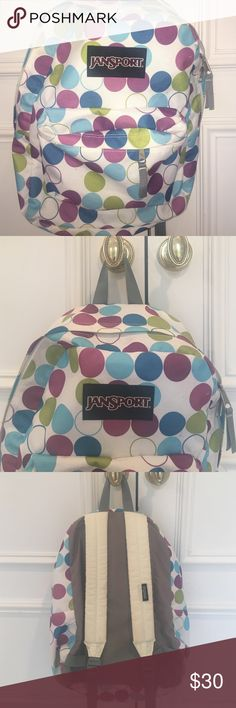 Jansport backpack Adorable! Gently used. There are some feint marks on the polka dot fabric, front and bottom and one on white strap, but they do not detract. See 4th photo. Jansport Bags Backpacks