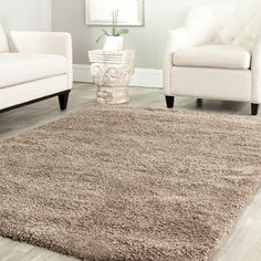 @Overstock.com - Safavieh Cozy Solid Taupe Shag Rug - Cover up a bare area or conceal imperfections in your flooring with this polypropylene shag rug. You'll want to sink your toes into the high pile after a day spent on your feet. The taupe color keeps your living room decor classy and elegant.  http://www.overstock.com/Home-Garden/Safavieh-Cozy-Solid-Taupe-Shag-Rug/7322533/product.html?CID=214117 $51.59