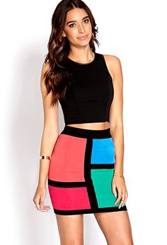 Colorblocked Sweater Skirt cute w some lace leggings a oversized black sweatshirt and black booties.