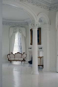 Interior room with tufted sofa at the Nottoway Plantation in Louisiana.