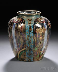 Wedgwood Fairyland Lustre Candlemas Vase, England, c. 1920, shape 2411, pattern Z5157 with bands of blue framing large black ground panels, printed mark, ht. 7 1/4 in. Designed by Daisy Makeig-Jones (1881–1945)