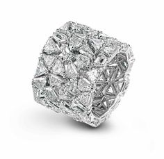 Chopard cigar band of trillion cut diamonds...