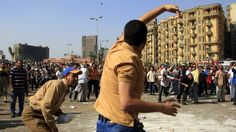 Clashes erupt between Muslim Brotherhood and Morsi's opponents in Tahrir Square